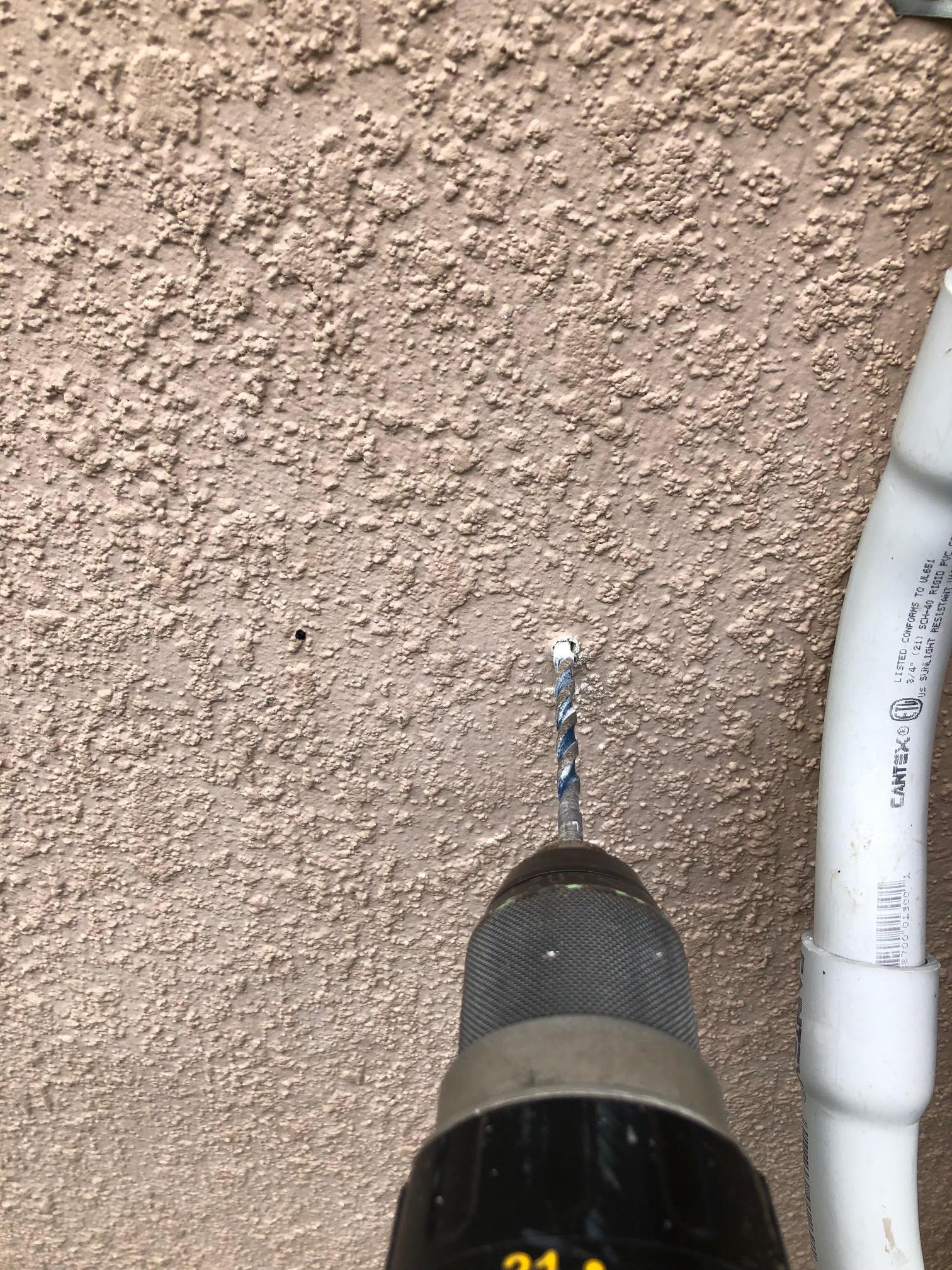 Drilling holes for low voltage landscape lighting transformer