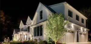 uplighting on farmhouse roof peaks